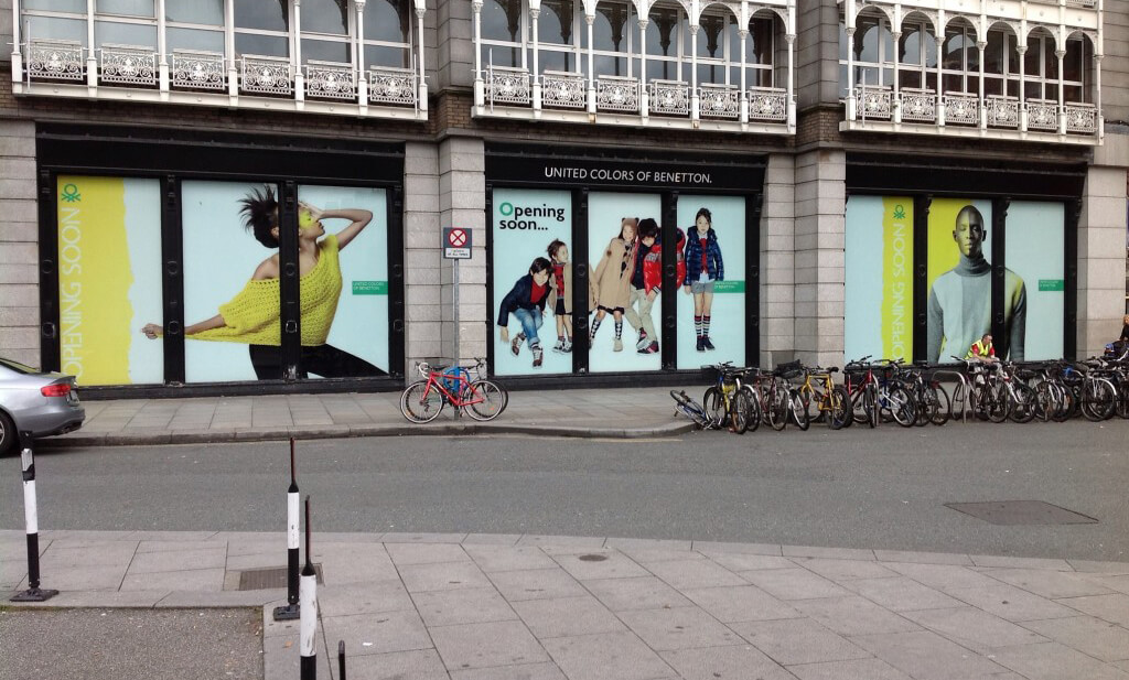Window Graphic outside Benneton shop at St. Stephens Green depicting happy children playing