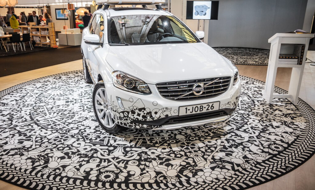 An exhibitions display from volvo with a print design carpet that is also featured on a volvo car