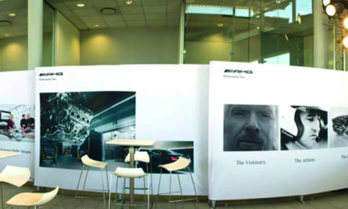 Exhibitions Wall that features a picture of Richard Branson