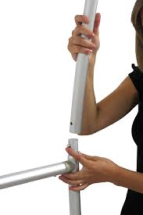 Woman showing how simple it is to assemble a fabric stand