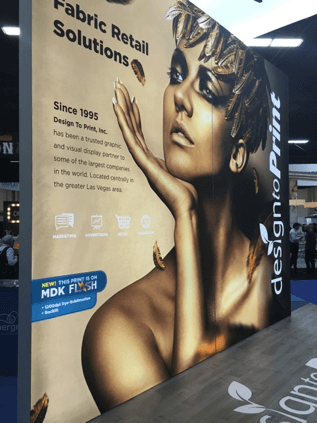 graphic display at globalshop 2016 depicting a woman painted gold
