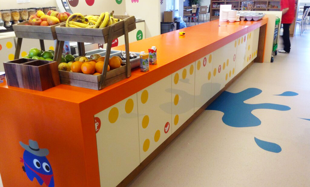 wall graphic at a serving station with a group of circles forming a design