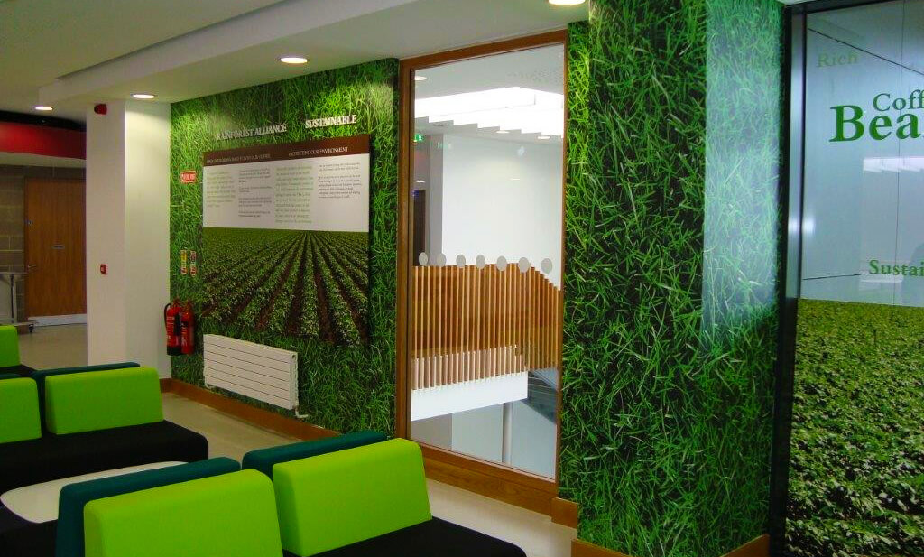 Wall graphic in an office that shows grass and shrubs