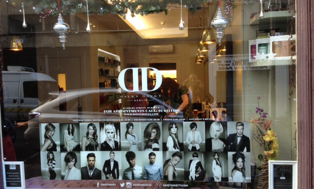 Window graphic for Davey Davey in Dublin with the logo and different modern hairstyles
